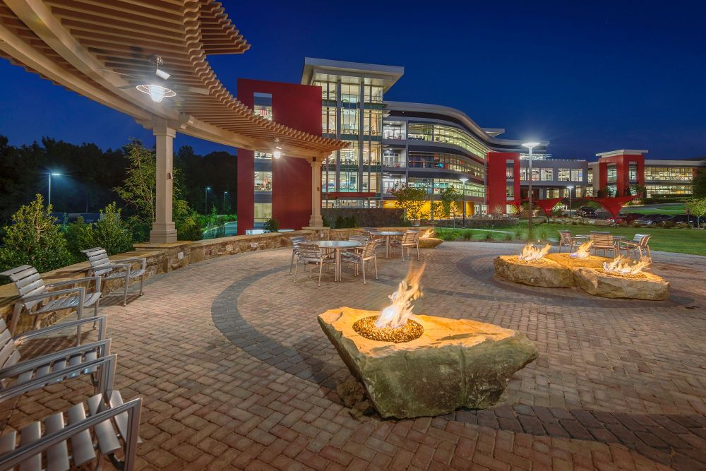 the-campus-landscape-at-red-ventures-includes-fire-pits-bocce-ball
